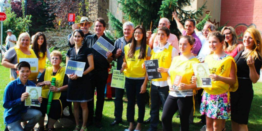 Le groupe Amnistie internationale de l'Académie Lafontaine, avec les invités d'honneur qui ont rendu hommage à Raïf Badawi.