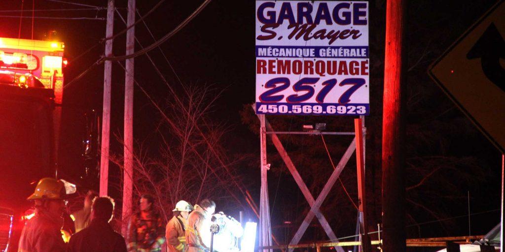 L'incendie a eu lieu au Garage S. Mayer, sur la route 158, à Sainte-Sophie, le soir du 8 mai 2016.